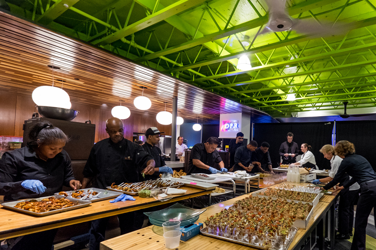 Behind the scenes at an event by Above & Beyond Catering