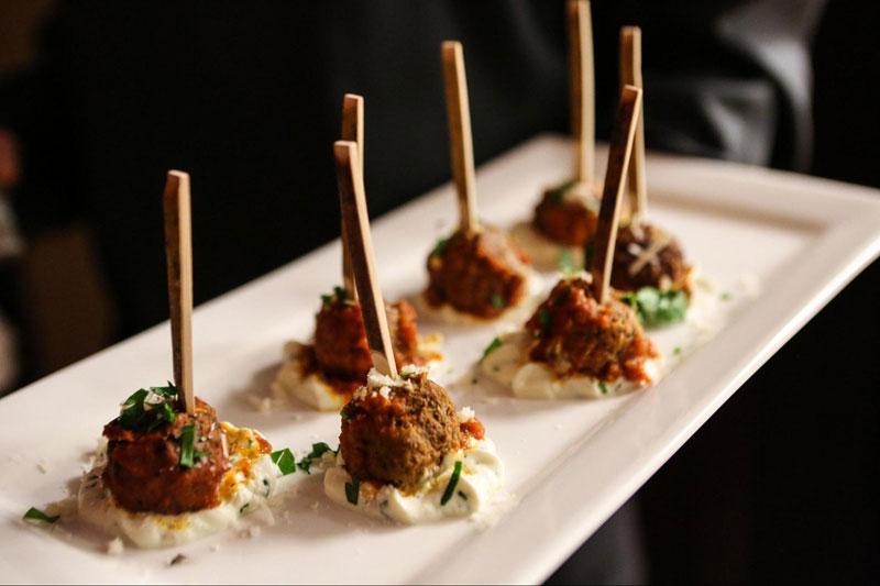 Mediterranean buffet chicken and beef kofta meatballs