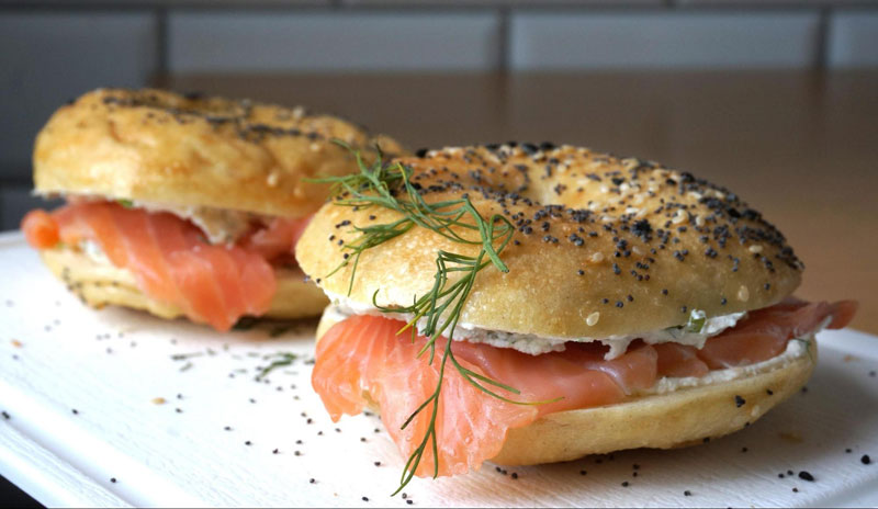 Norwegian Breakfast Sandwich with Smoked Salmon on a Onion Bagel